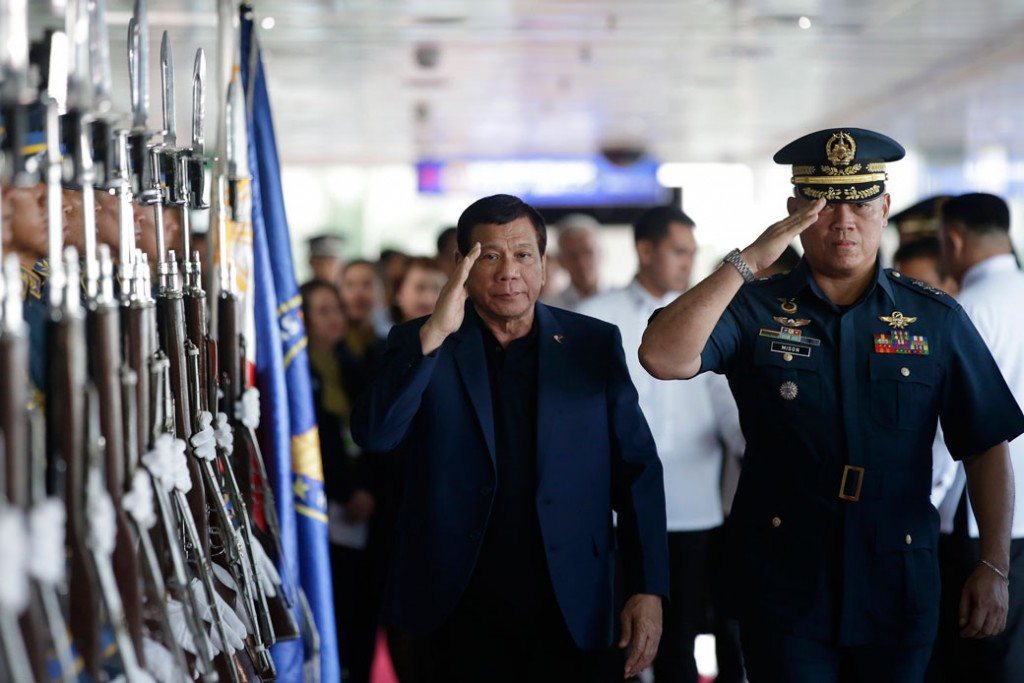Filipino President Rodrigo Duterte salutes during an arrival honor at Manila's international airport in the Philippines, May 24, 2017.