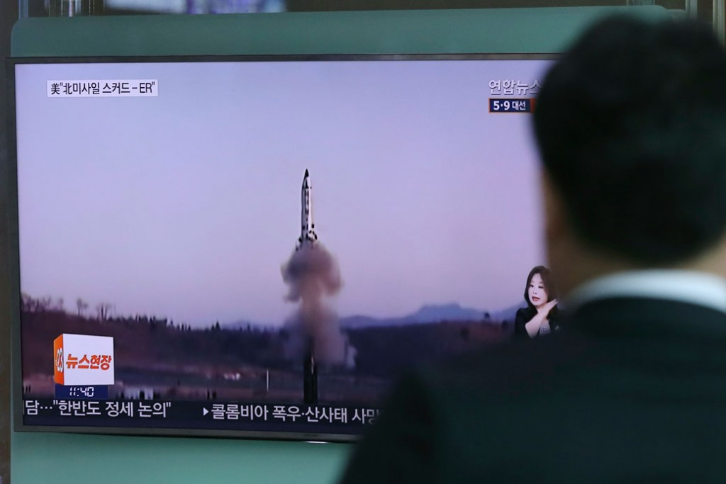 In Seoul, South Korea, a man watches a TV news program reporting about North Korea's missile firing, April 6, 2017.