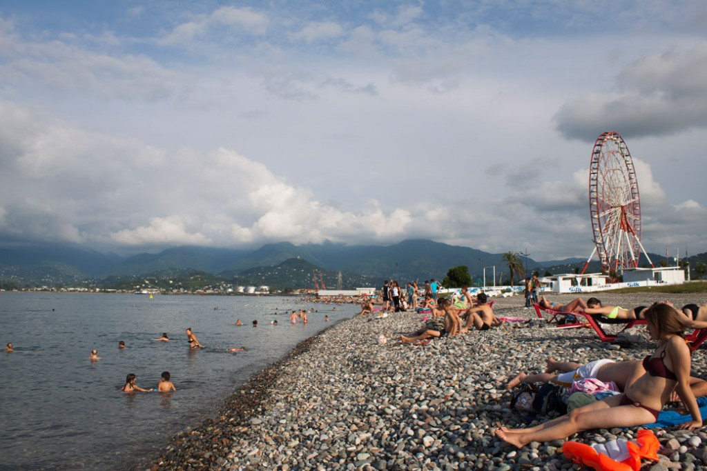 Tourists swim and sunbathe in the Black Sea resort town of Batumi, Georgia, August 1, 2012.
