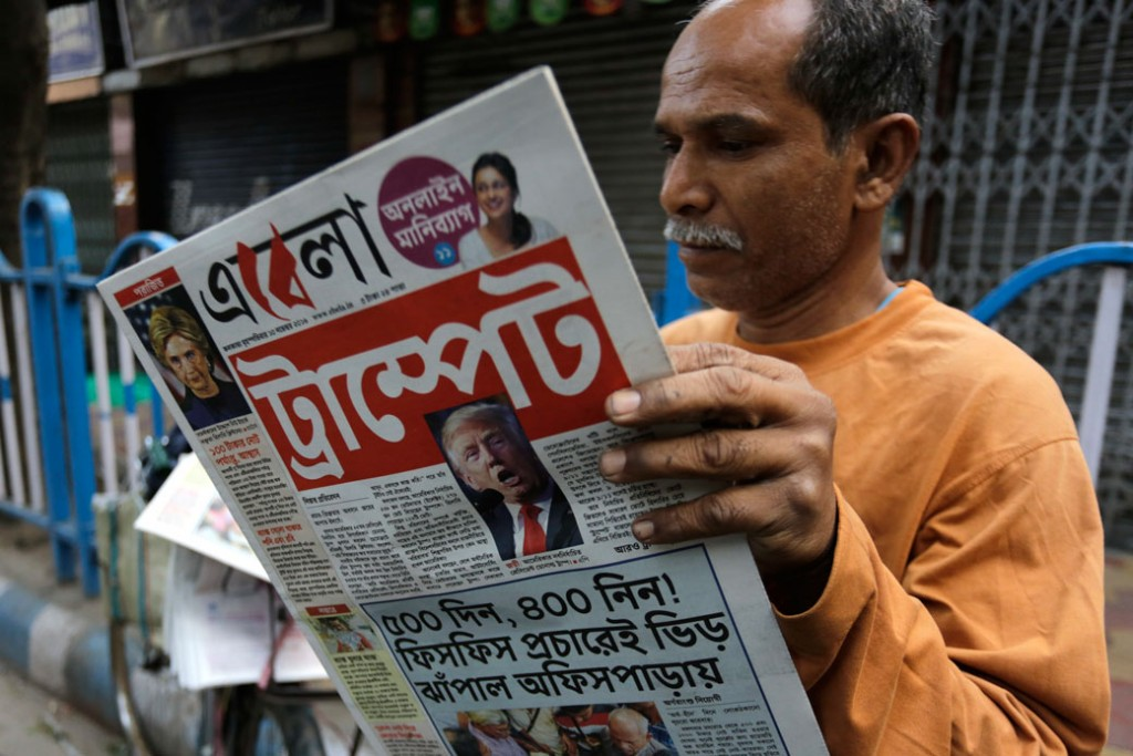 An man reads a Bengali-language newspaper in Kolkata, India, November 10, 2016.