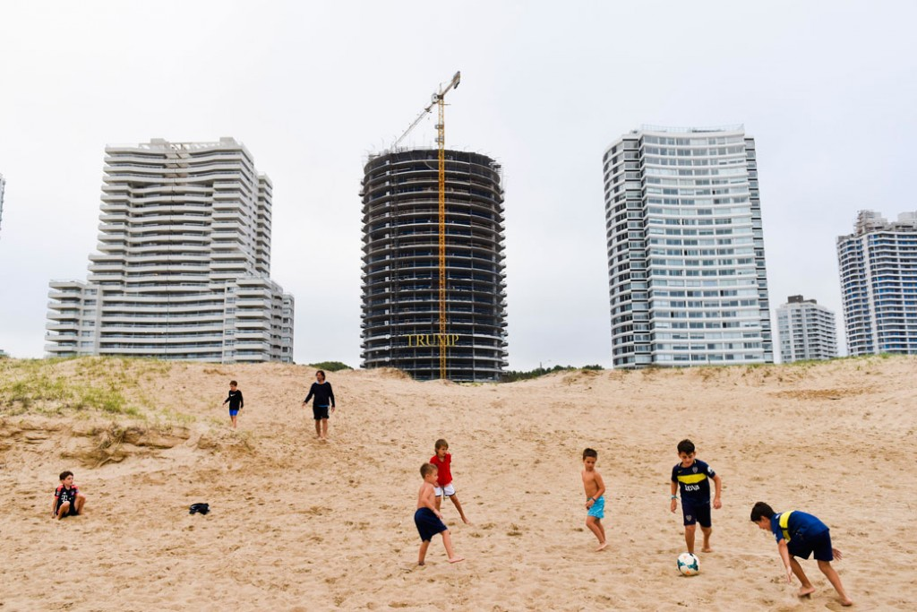 Children play in front of the Trump Tower under construction in Punta del Este, Uruguay, January 17, 2017.