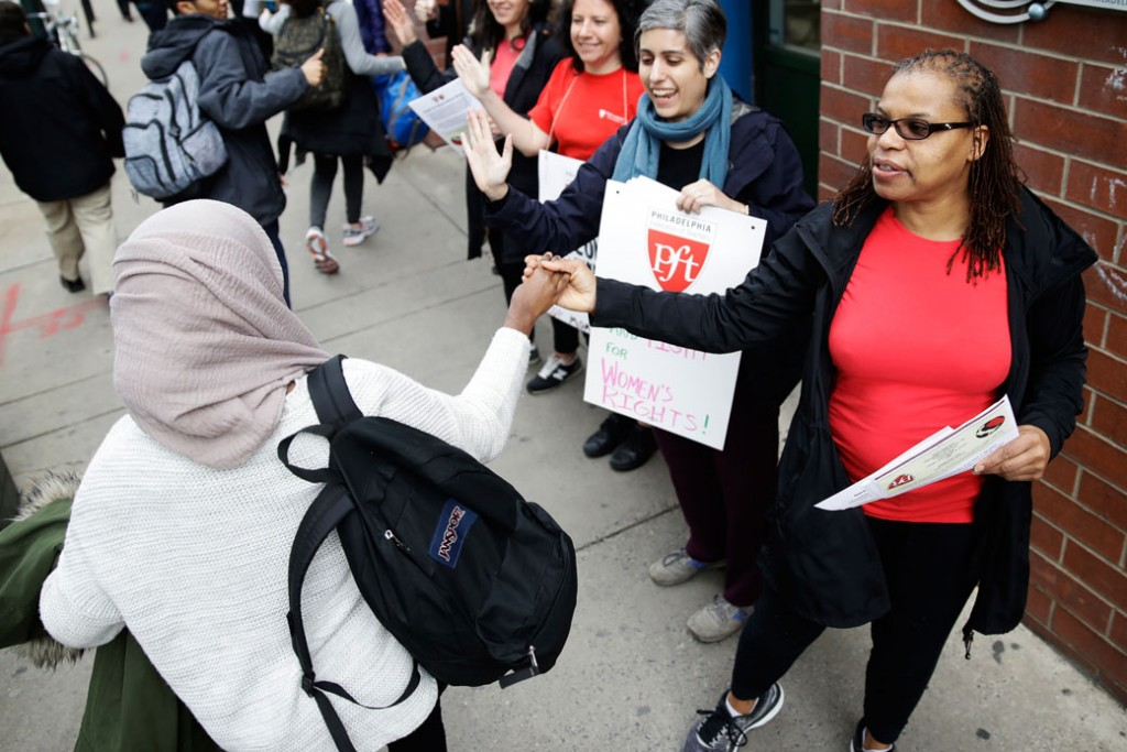 "Teachers greet students as they arrive at the Science Leadership Academy in Philadelphia for the ""A Day Without a Woman"" demonstration, on March 8, 2017."