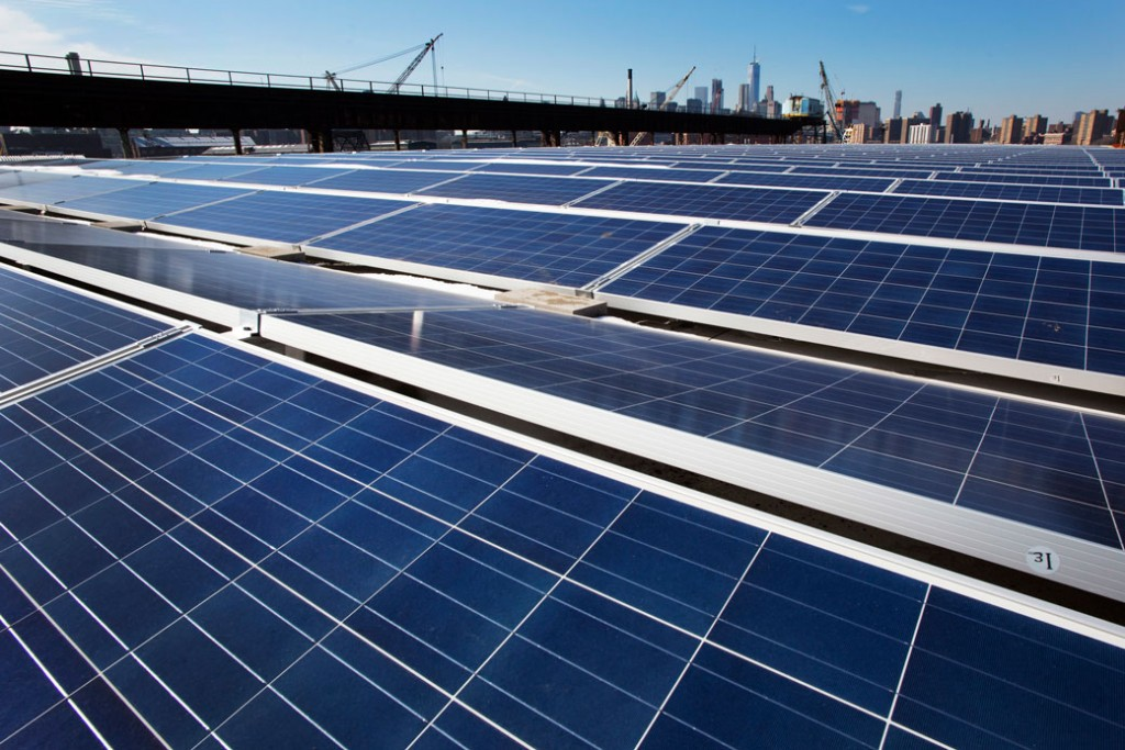 A rooftop is covered with solar panels at the Brooklyn Navy Yard, February 14, 2017, in New York.