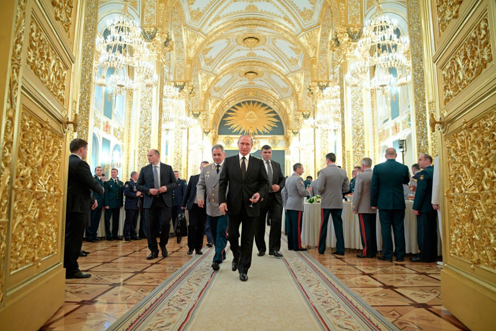 Russian President Vladimir Putin, front, attends a meeting with graduates of military and police academies in the Kremlin in Moscow, Russia, Wednesday, June 28, 2017.
