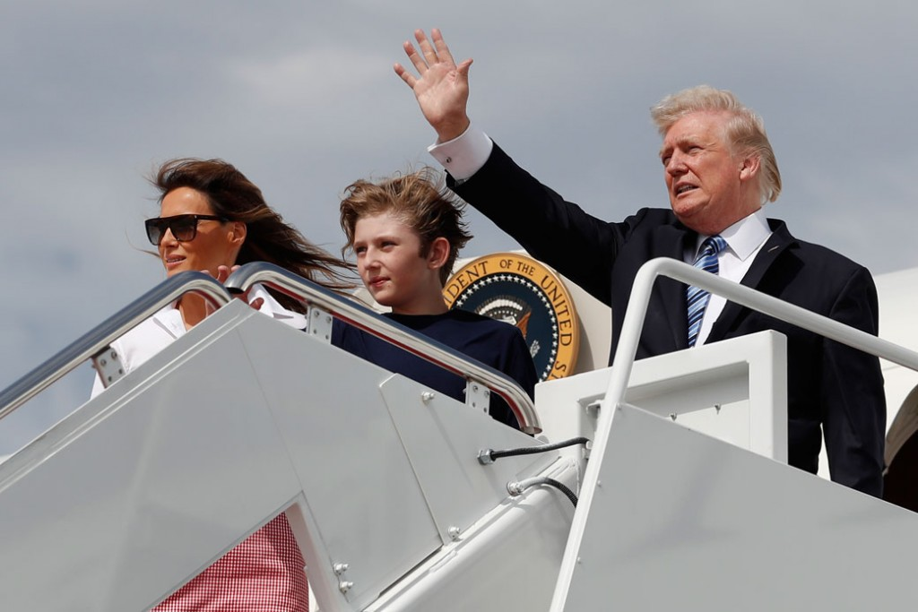 President Donald Trump, first lady Melania Trump, and their son Barron Trump board Air Force One, June 30, 2017.
