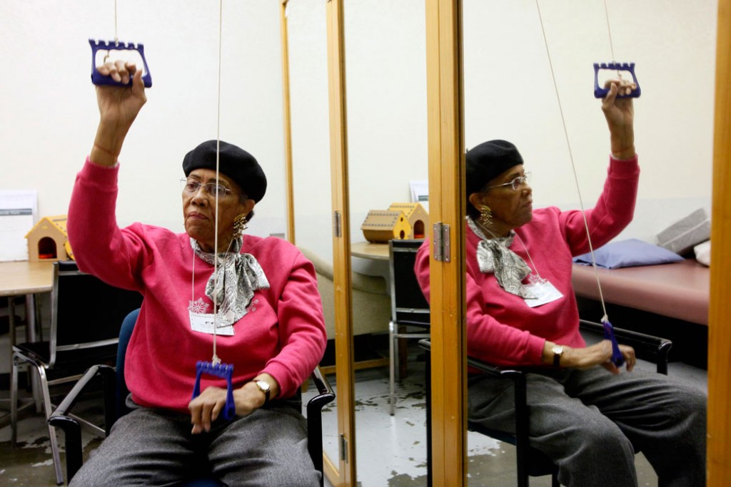 A woman works out at the Adult Day Health Care center in Los Angeles, March 8, 2011.
