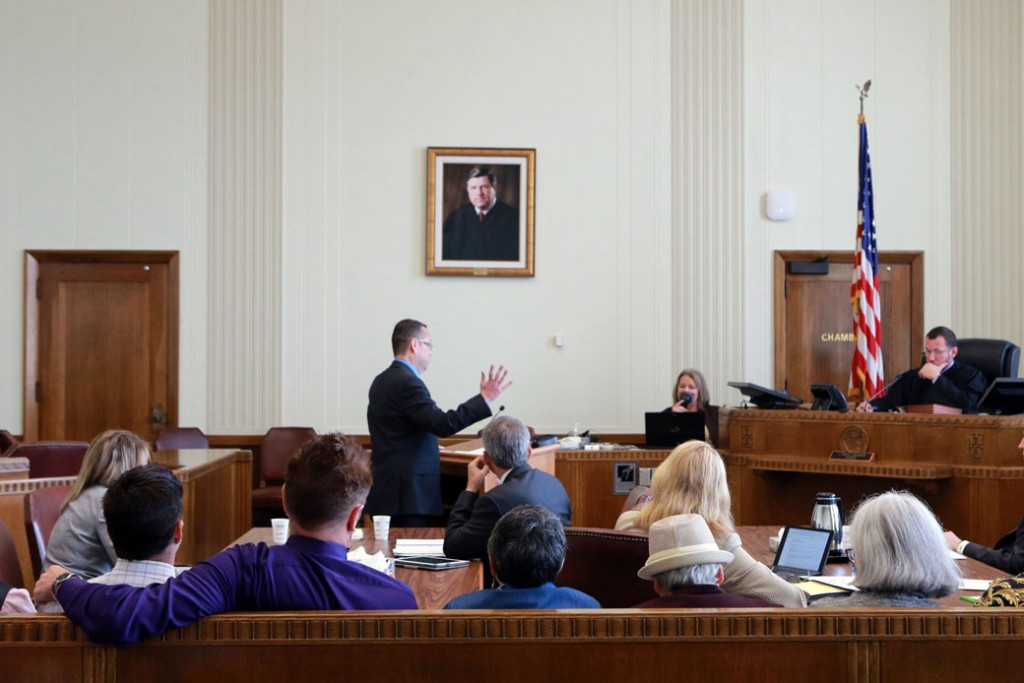 Plaintiffs in a class-action lawsuit against the state of Missouri watch during a hearing in Kansas City, Missouri, September 25, 2014.