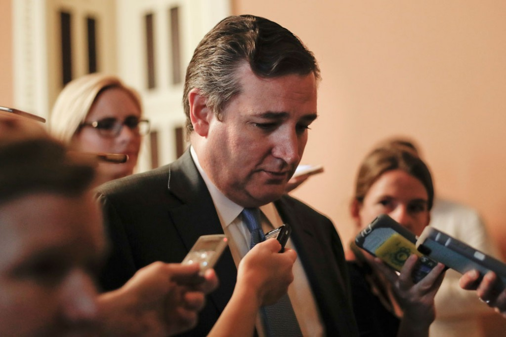 Sen. Ted Cruz (R-TX) is pursued by members of the media while walking the hallways on Capitol Hill in Washington, Thursday, July 13, 2017.