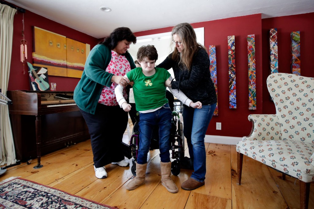 An in-home nurse helps steady her patient in Brentwood, New Hampshire, on March 17, 2017.