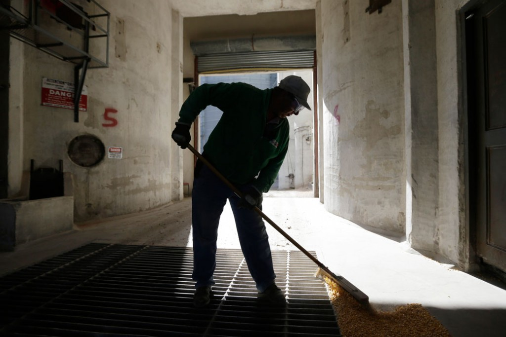 An elevator employee sweeps corn in Thornton, Iowa, on October 13, 2017.