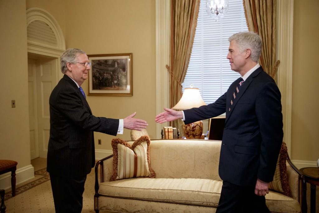 Then-Supreme Court Justice nominee Neil Gorsuch is greeted by Senate Majority Leader Mitch McConnell on Capitol Hill in Washington, February 2017.