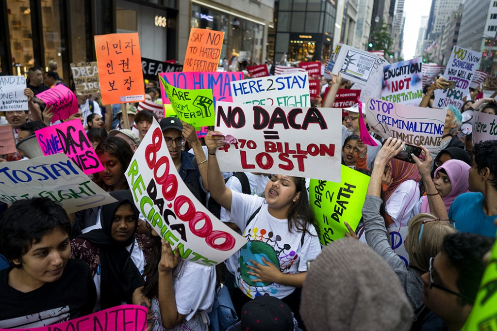 Activists supporting Deferred Action for Childhood Arrivals (DACA) and other immigration issues gather near Trump Tower in New York, August 2017.