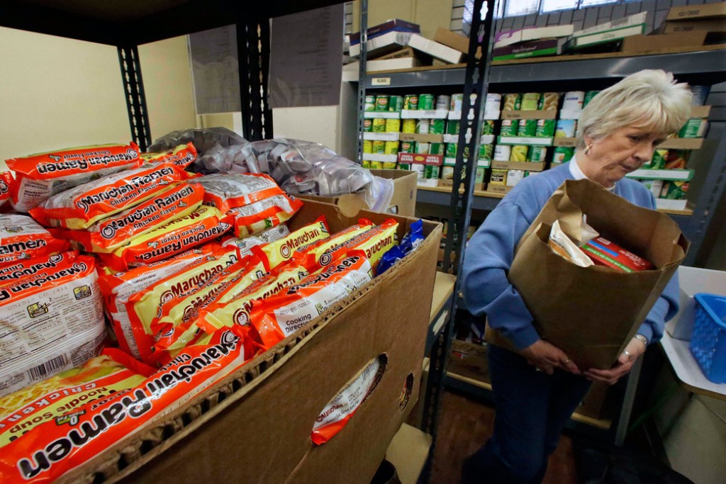 A woman prepares food supplies to be distributed to people in need in Springfield, Illinois, January 15, 2013.