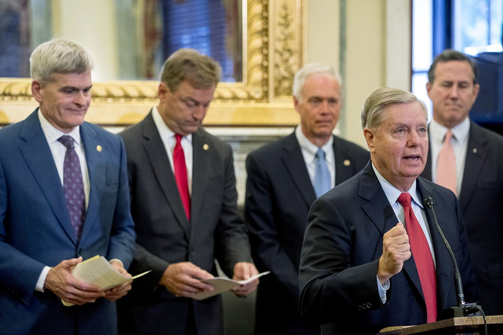 From left, Sen. Bill Cassidy (R-LA). Sen. Dean Heller (R-NV), Sen. Ron Johnson (R-WI), Sen. Lindsey Graham (R-SC), and former Sen. Rick Santorum (R-PA) hold a press conference on Capitol Hill in Washington, September 13, 2017, to unveil legislation to reform health care. (AP Photo/Andrew Harnik)