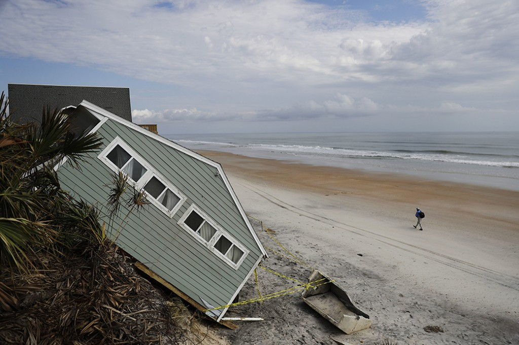 A house rests on the beach after collapsing off a cliff from Hurricane Irma in Vilano Beach, Florida, September 15, 2017.