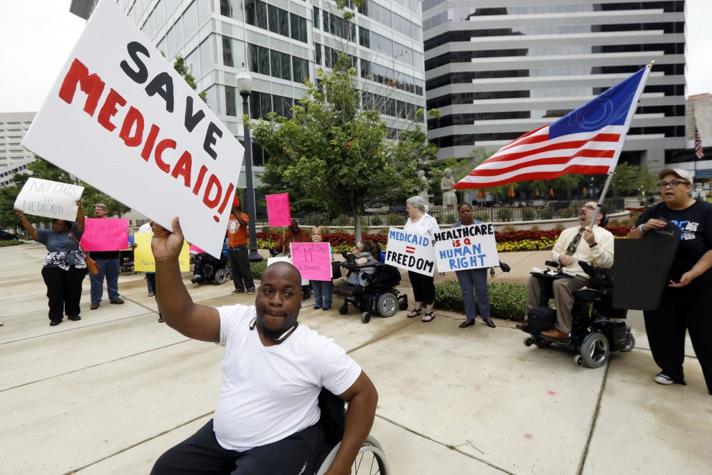 Medicaid recipients and their supporters stage a protest outside the building that houses the offices of U.S. Sen. Thad Cochran (R-MS).