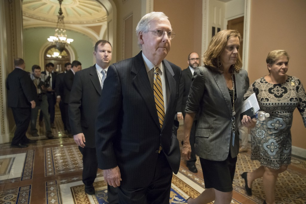Senate Majority Leader Mitch McConnell (R-KY) heads to a meeting to discuss a tax code overhaul on September 12, 2017.