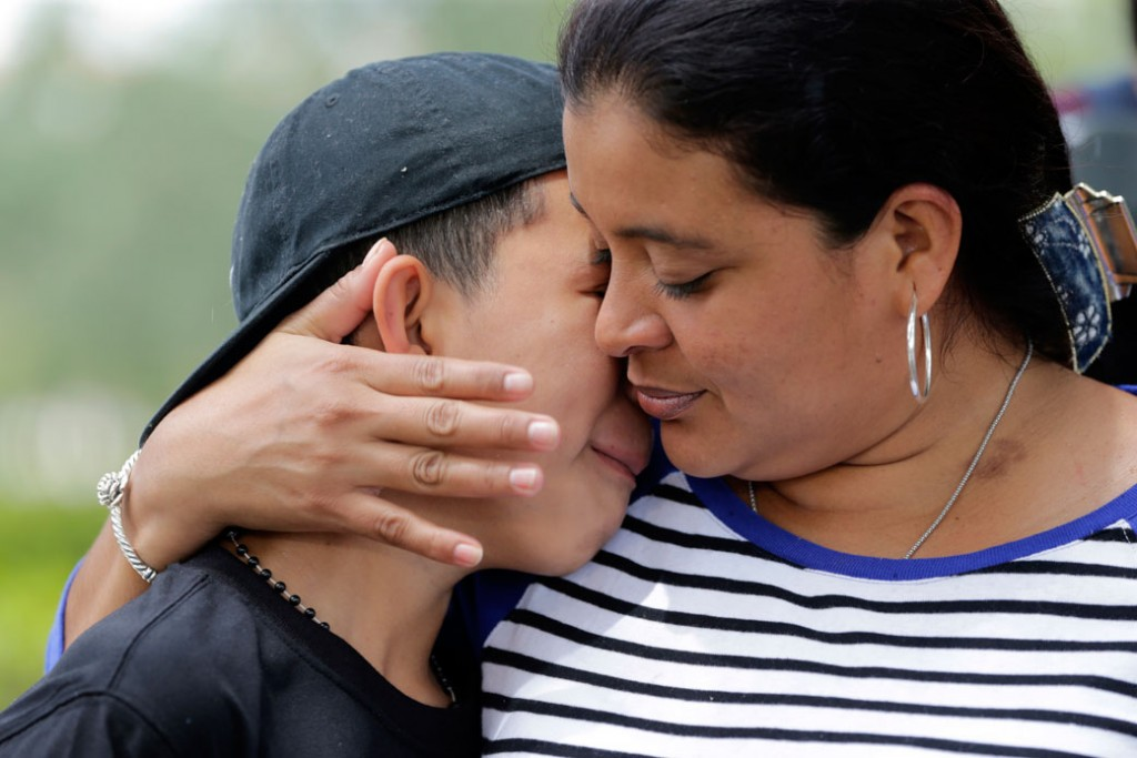 A mother embraces her son outside of the U.S. Citizenship and Immigration Services office in Miramar, Florida, May 19, 2017.