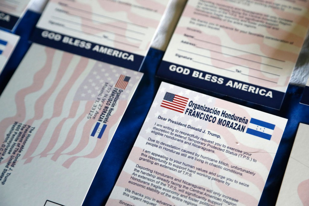 Postcards addressed to President Donald Trump asking him to extend Temporary Protected Status for tens of thousands of Central Americans and Haitians are shown during a news conference in Miami, Florida, June 7, 2017.