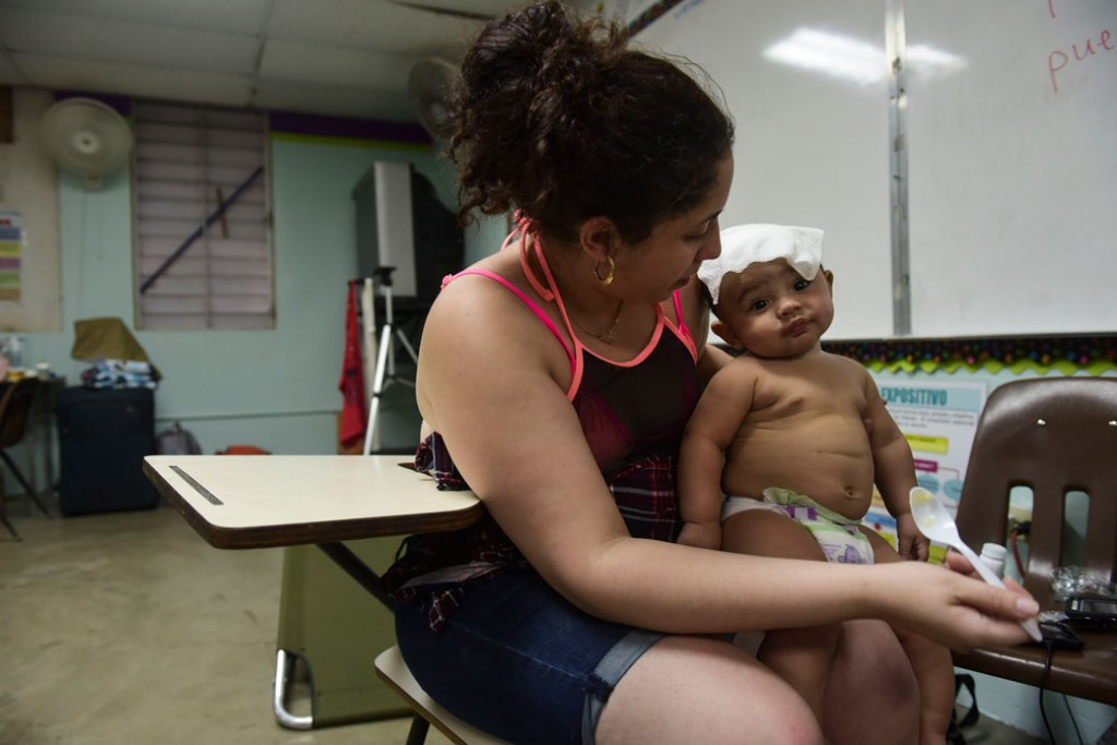 A mother and her son take refuge at an elementary school in Humacao, Puerto Rico, before the arrival of Hurricane Maria, September 19, 2017.