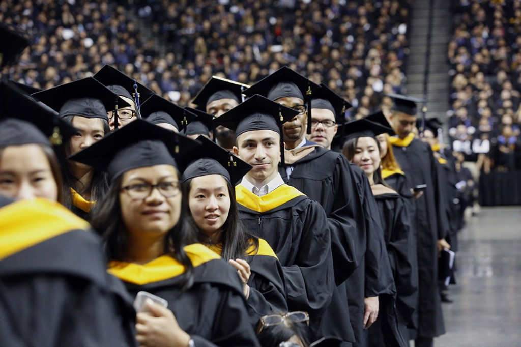 College graduates participate in a commencement program, June 2017, in the Brooklyn borough of New York.