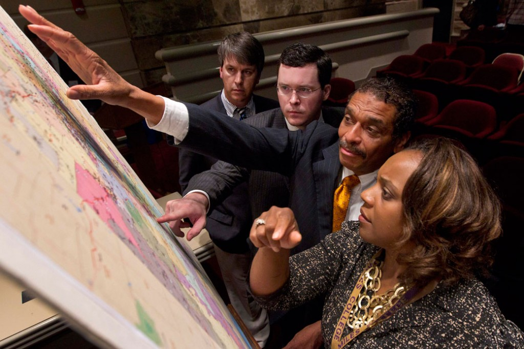 Lawmakers study a map of a proposed redistricting plan at the State House in Montgomery, Alabama, May 9, 2012.