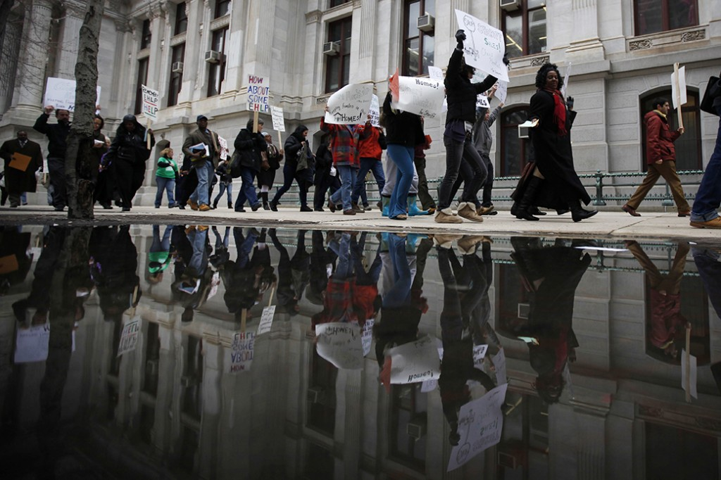 Protesters facing foreclosure and their advocates march March 24, 2011, outside City Hall in Philadelphia, Pennsylvania.