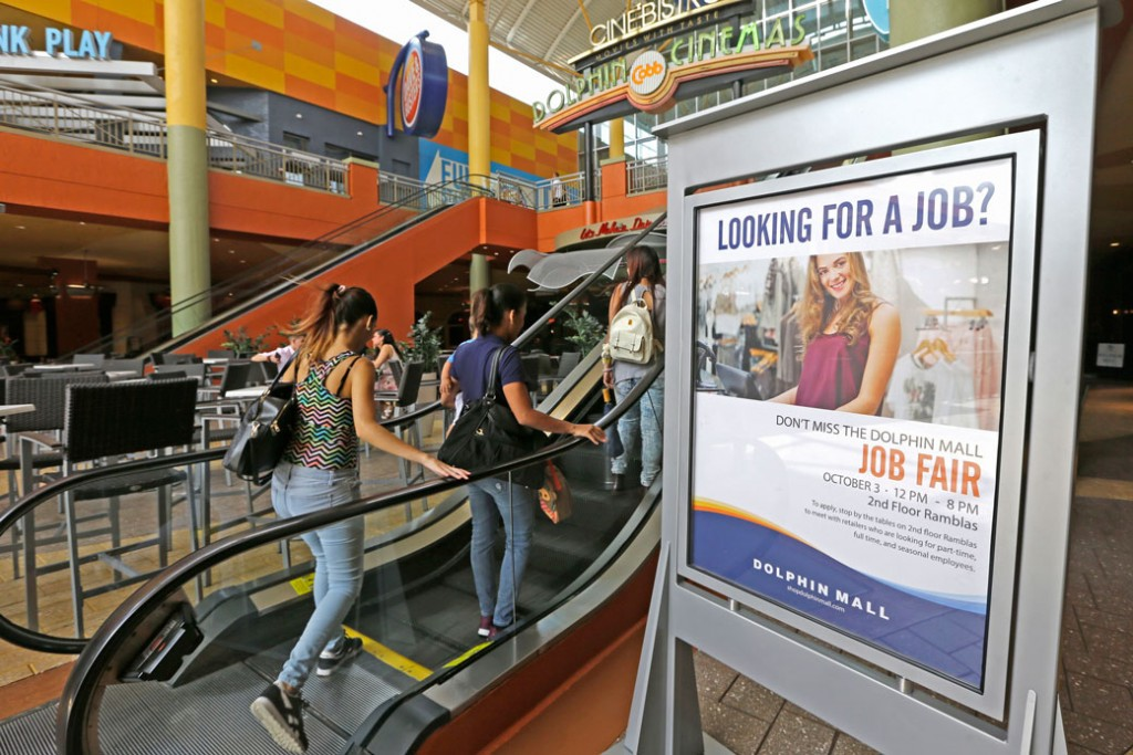 People head to at a job fair at a mall in Sweetwater, Florida, October 2017.