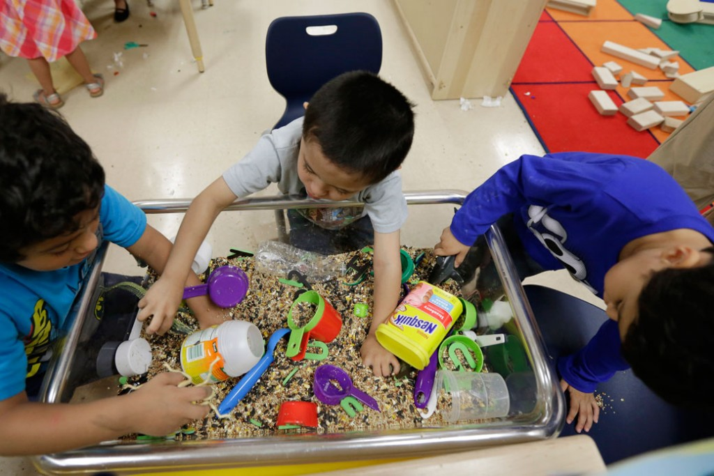 Pre-K students play with educational toys at an education center, April 2, 2014, in San Antonio.