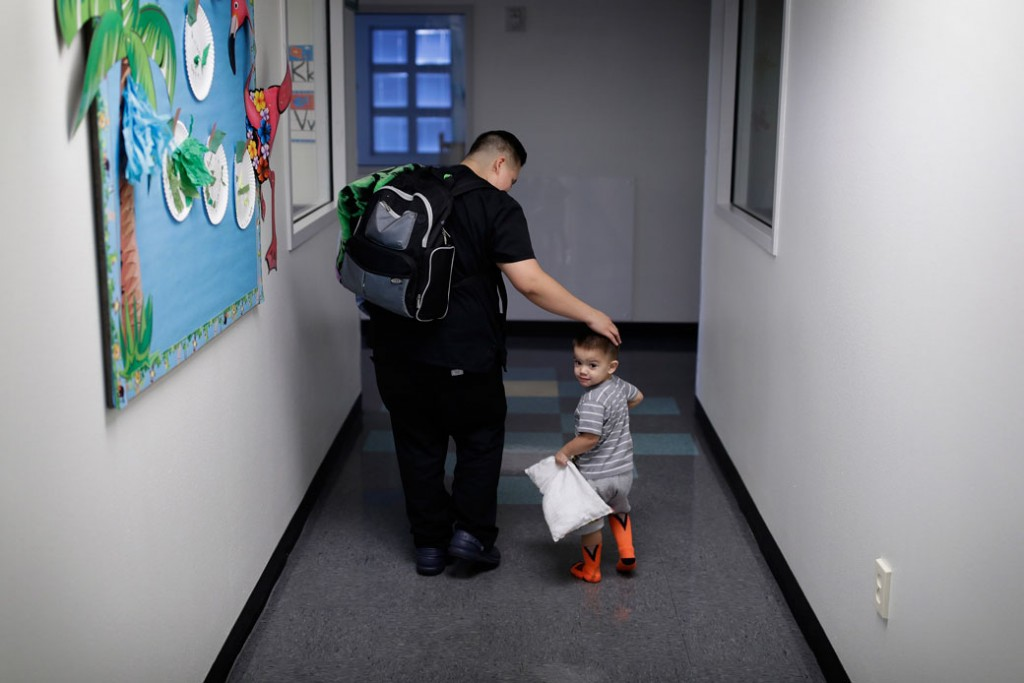 A mother picks up her 2-year-old son at a child development center in Las Vegas.