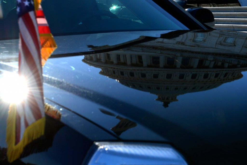 The Capitol Dome is reflected on the hood of one of the presidential limousines as it is parked on Capitol Hill in Washington, November 2017.