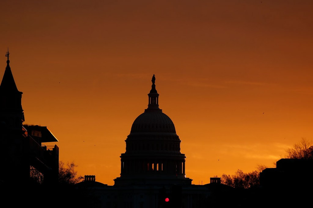 The Capitol Dome is seen silhouetted by the rising sun on Capitol Hill, November 2017.
