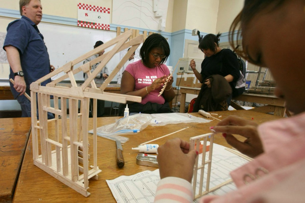 New York high school students build a model design of a house frame, March 2007.