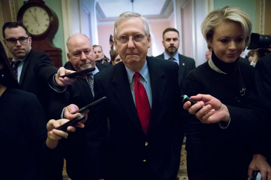 Senate Majority Leader Mitch McConnell walks to the chamber after a closed-door meeting with Republican lawmakers.