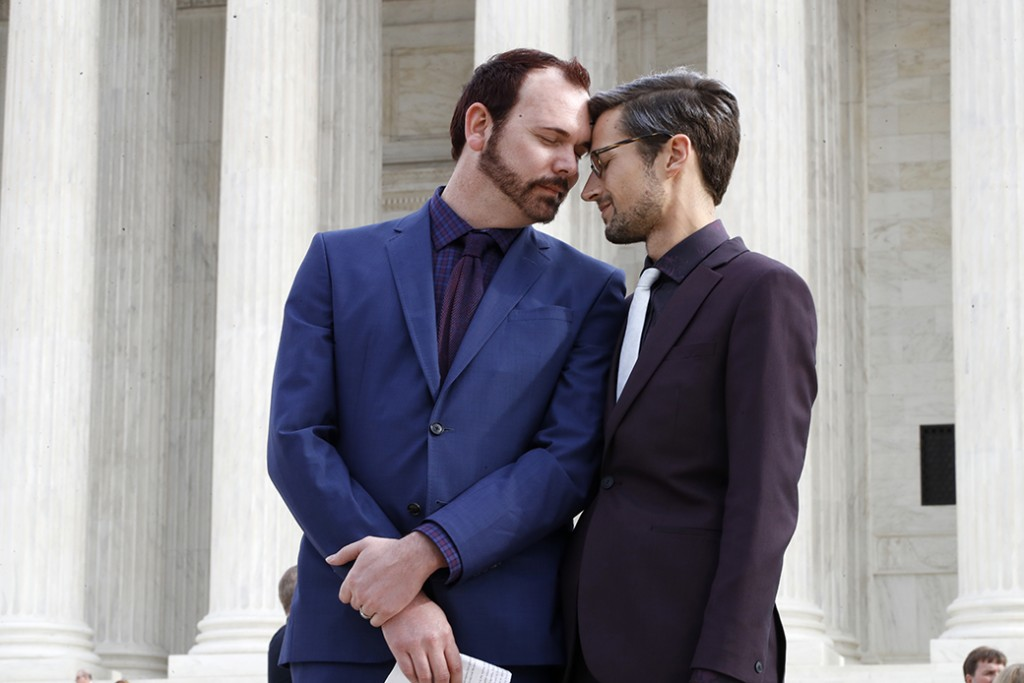 Charlie Craig, left, and David Mullins touch foreheads after leaving the Supreme Court, which heard <em>Masterpiece Cakeshop v. Colorado Civil Rights Commission</em>, December 5, 2017, in Washington.