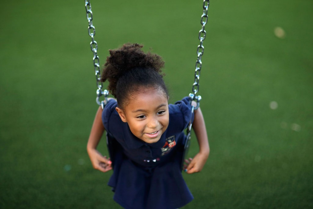 A 6-year-old sits on a swing at a child development center in Las Vegas, September 13, 2017.