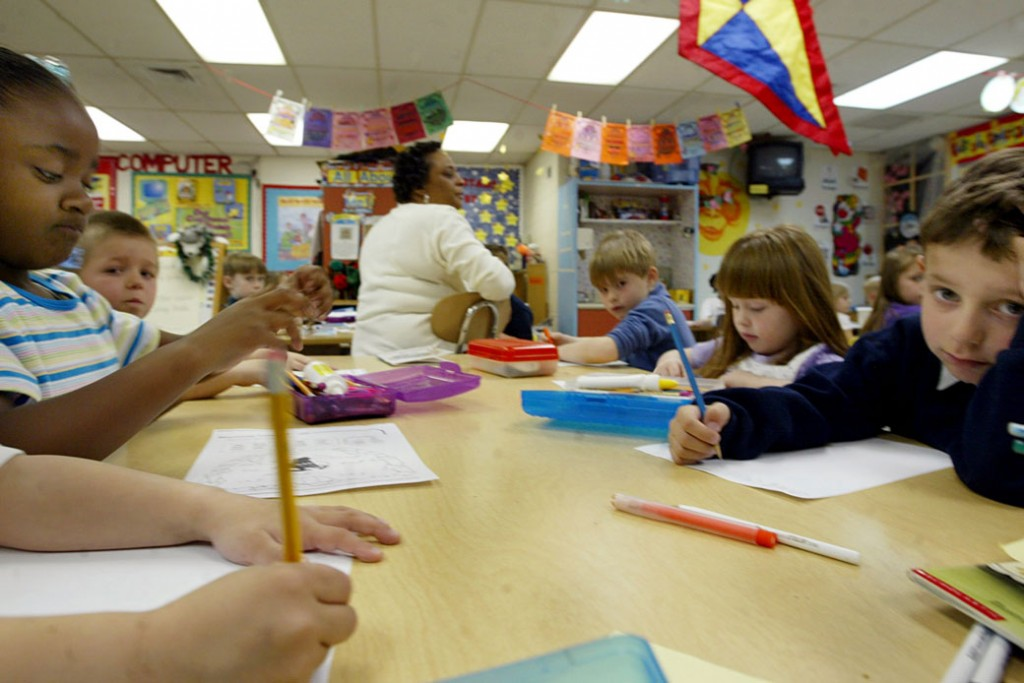 Kindergarten students in Farmville, Virginia, work on an assignment, April 2004.