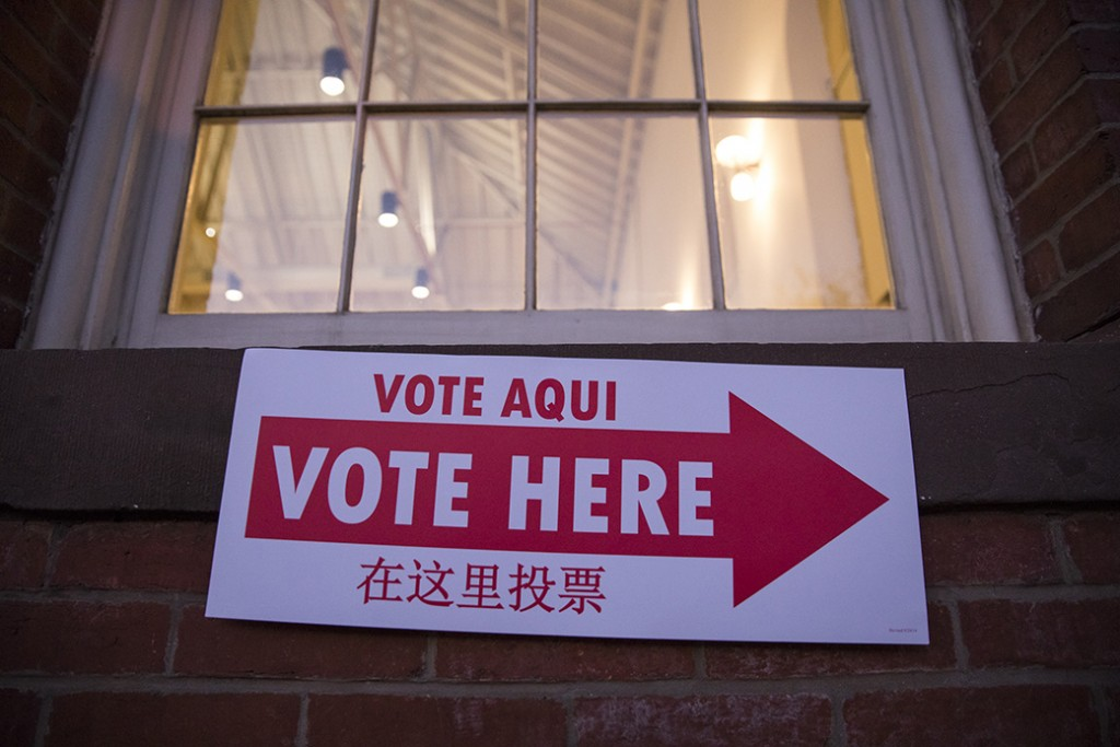 A sign directing voters to the polling center is seen on a wall in Eastern Market as the sun rises on the 2016 presidential election in Washington, November 8, 2016.
