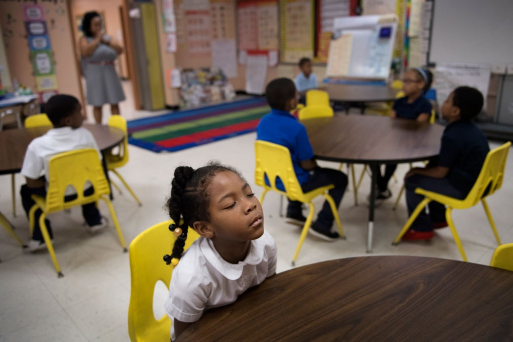 A Baltimore first-grader participates in a morning meditation session with her class, November 2016.