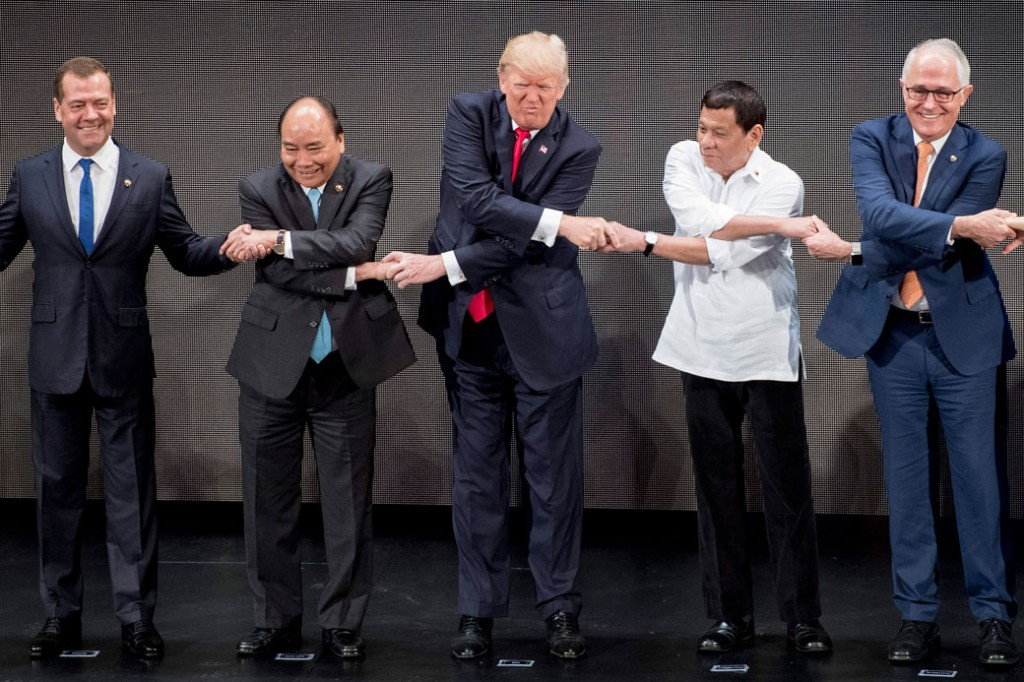 President Trump joins hands with other foreign leaders for a photo during the opening ceremony of the 31st Association of Southeast Asian Nations (ASEAN) Summit in Manila, Philippines, on November 13, 2017.