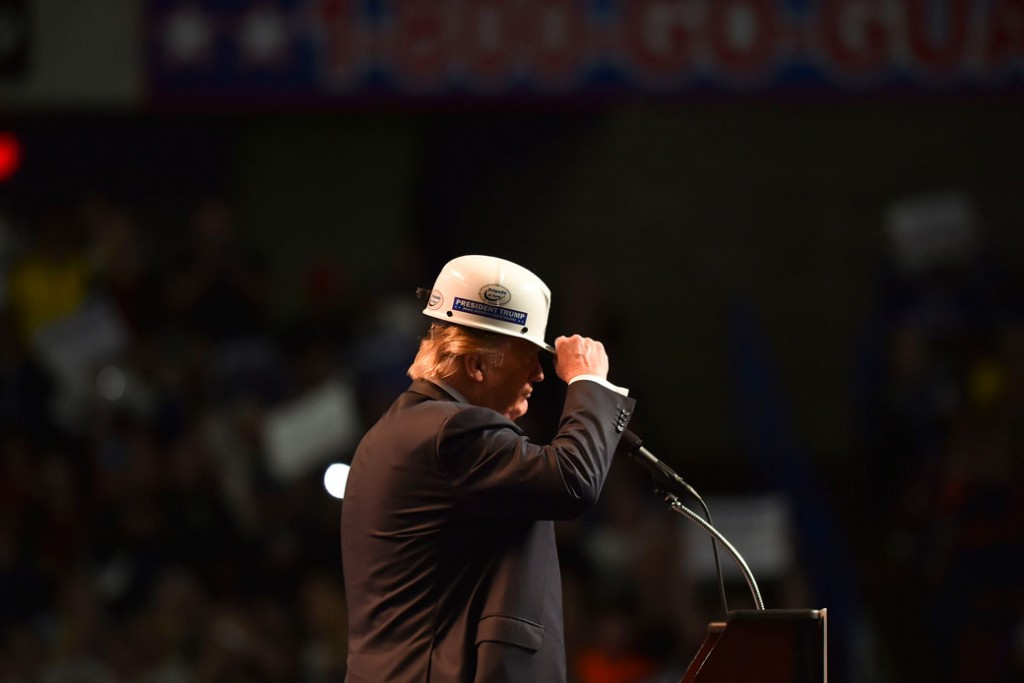 Then-presidential candidate Donald Trump wears a coal miner's protective hat while addressing his supporters during a rally at the Charleston Civic Center on May 5, 2016, in Charleston, West Virginia.