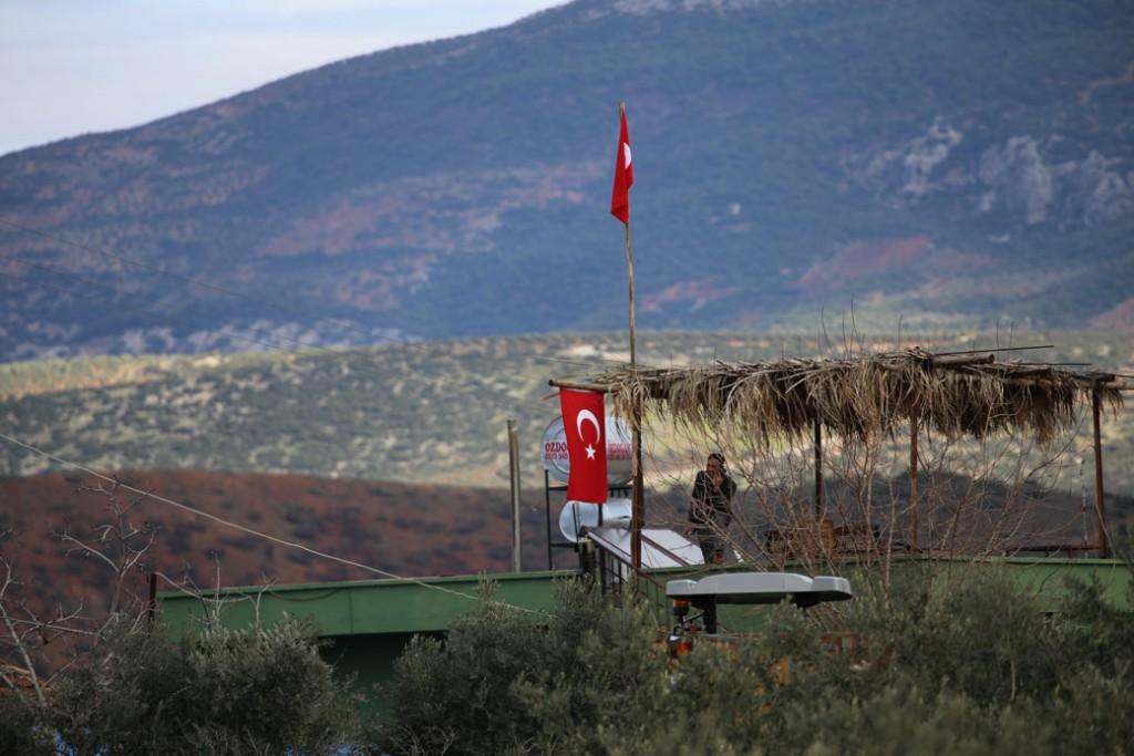 People hang Turkish flags in Sugedigi neighbourhood of Hassa district in Hatay, Turkey, on January 19, 2018.