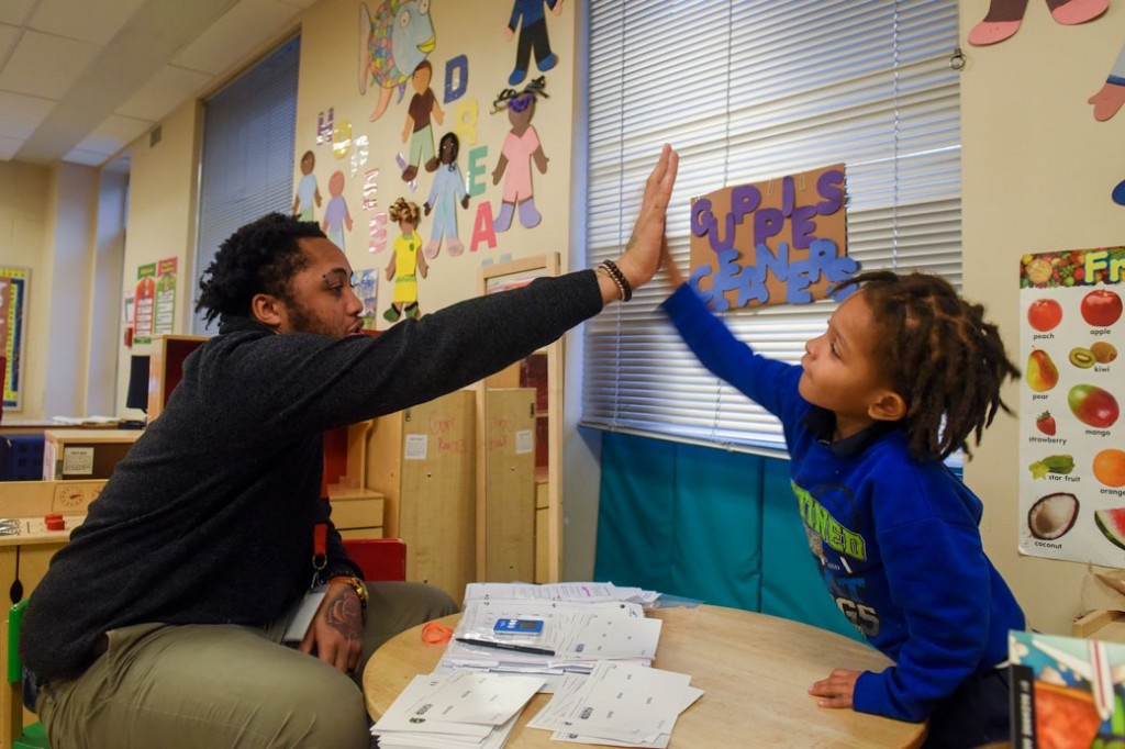 A student high-fives his teacher in a Washington, D.C., classroom, on January 23, 2016.