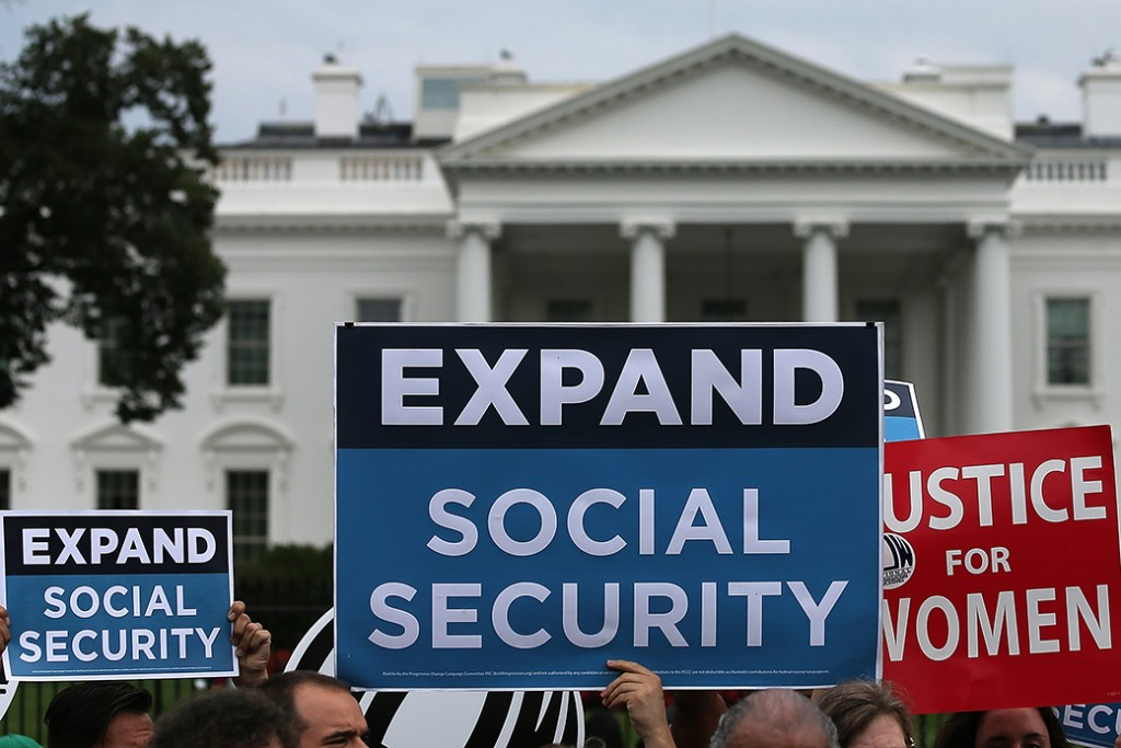 Activists participate in a rally urging the expansion of Social Security benefits in front of the White House, July 13, 2015, in Washington, D.C.