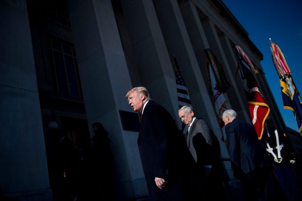 President Donald Trump, Defense Secretary Jim Mattis, and Vice President Mike Pence walk into the Pentagon for a meeting on January 18, 2018.