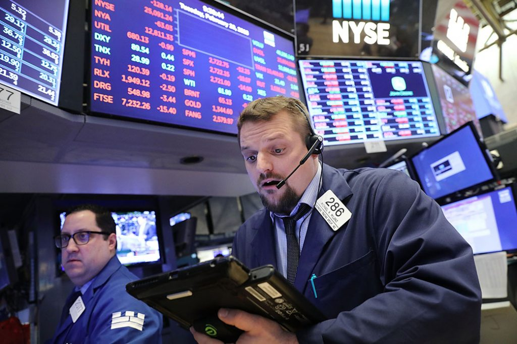 Traders work on the floor of the New York Stock Exchange on February 20, 2018, in New York City.