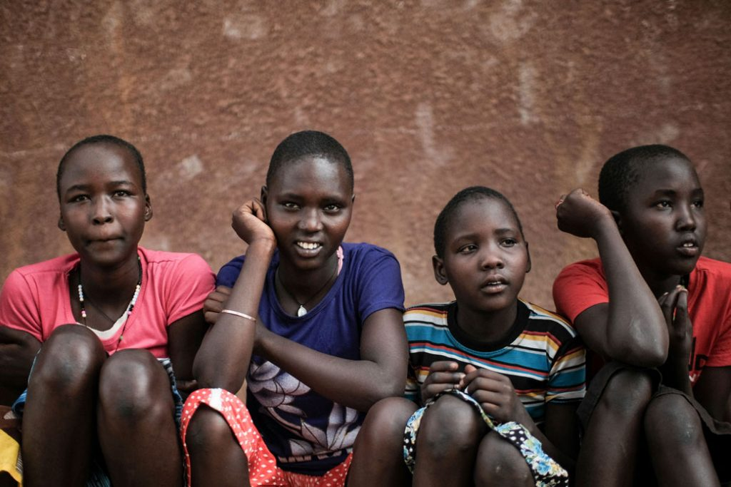 Four girls are seen in a town in northeast Uganda, January 2018.