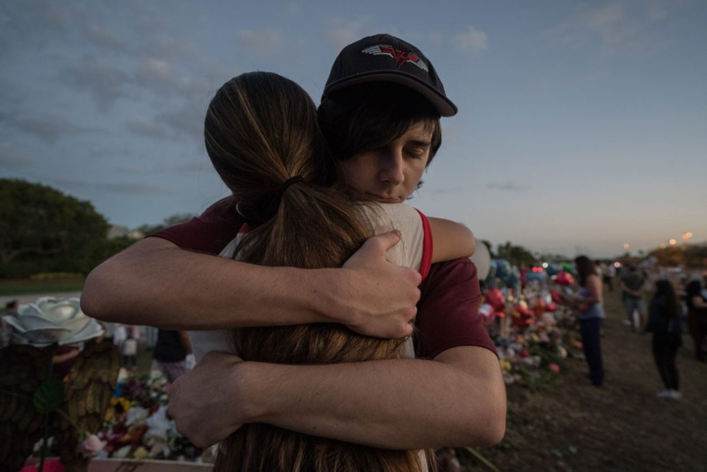 Two students hug at Marjory Stoneman Douglas High School in Parkland, Florida, on February 25, 2018.