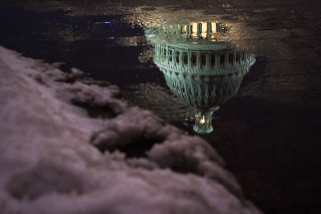 WASHINGTON, DC - MARCH 21: A reflection of the US Capitol Building dome is seen as the sun sets after a Spring snow fall on Wednesday, March 21, 2018 in Washington, DC. (Photo by Jabin Botsford/The Washington Post via Getty Images)