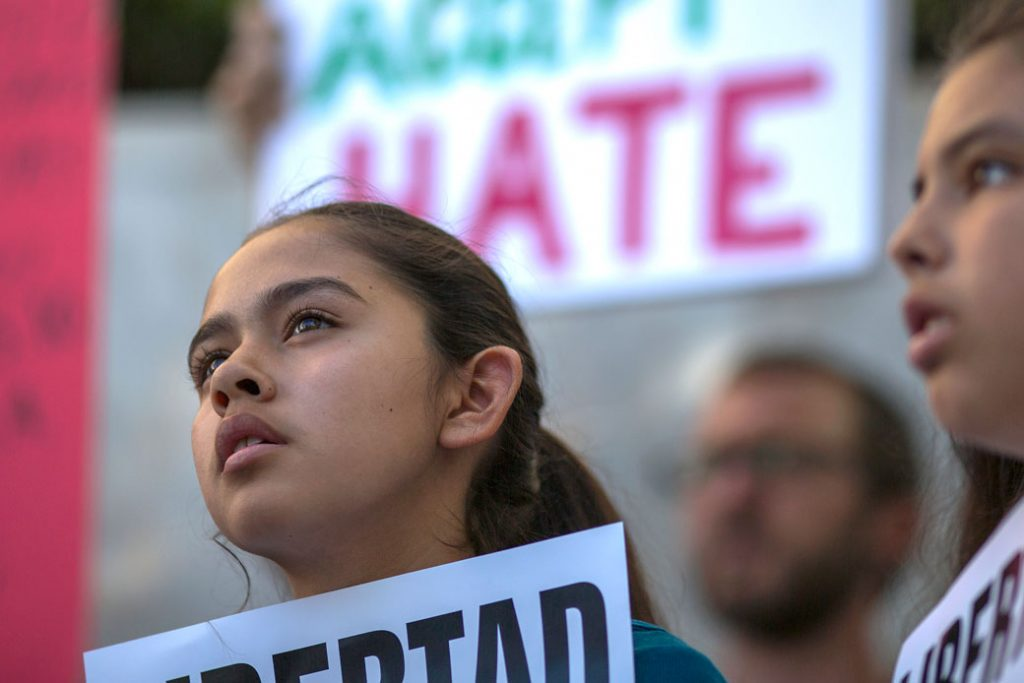 Fatima Avelica protests her father's detainment while in front of U.S. Immigration and Customs Enforcement (ICE) offices in Los Angeles, March 13, 2017.